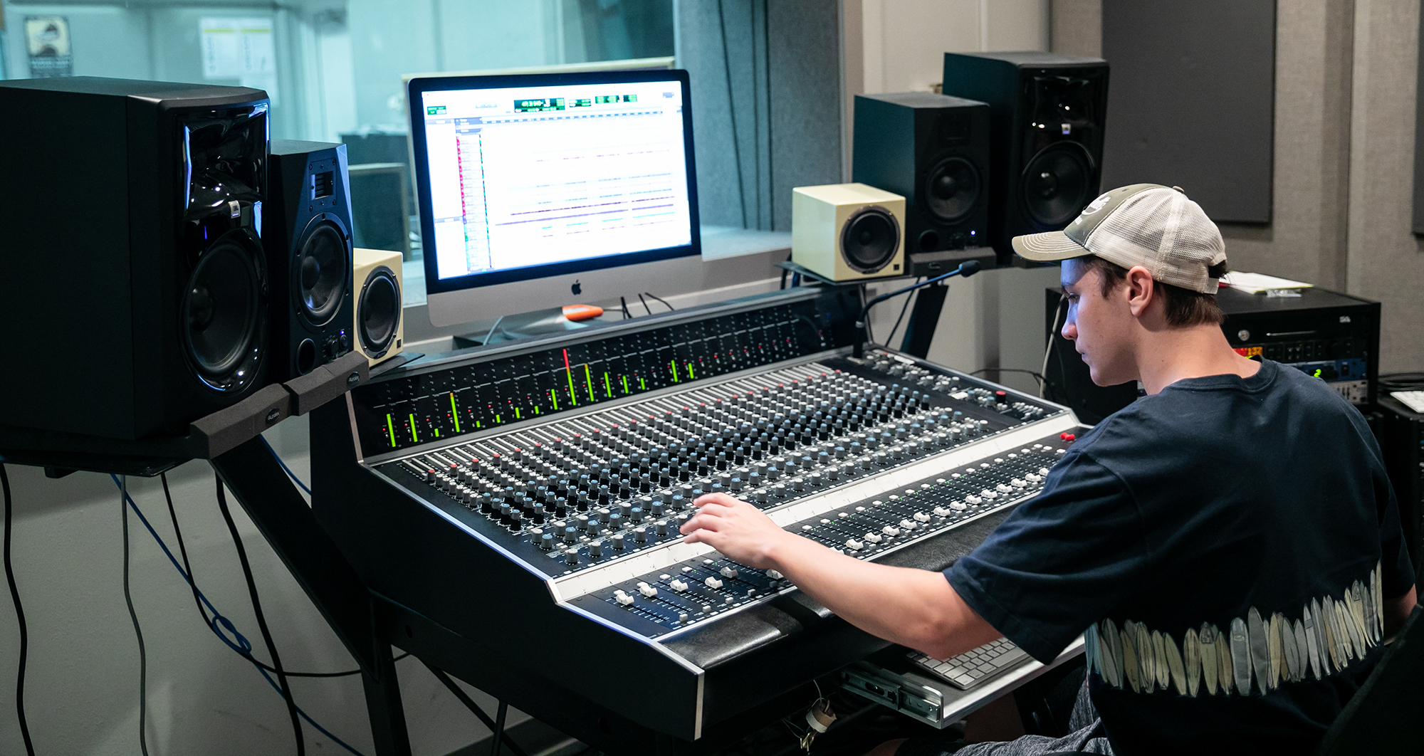 A student inside the sound studio