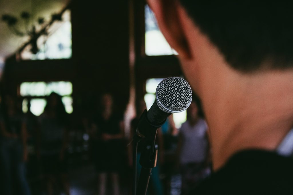 A person speaking into a microphone
